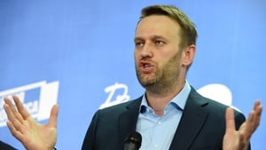 Alexei Navalny urging Russians to boycott voting following his barring from the election