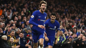 Marcos Alonso celebrates his goal with Alvaro Morata against Brighton.