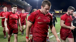 CJ Stander and his Munster team-mates leave the field dejected