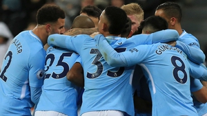 Manchester City players mob Raheem Sterling after his decisive goal