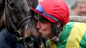 Robbie Power celebrates last year's Cheltenham Gold Cup success with Sizing John