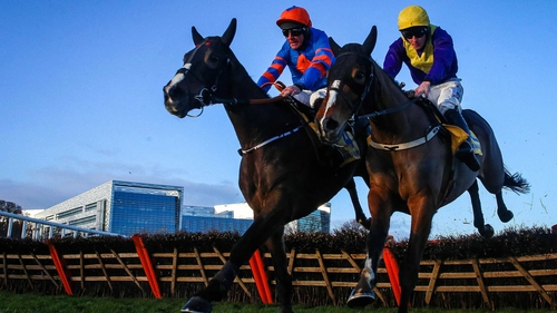 Davy Russell onboard Mick Jazz (l) clears the last on his way to winning ahead of David Mullins onboard Cilaos Emery
