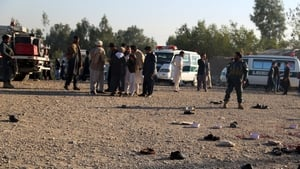 Security officials observe the scene following the blast