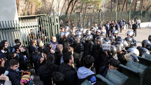 Iranian students scuffle with police at the University of Tehran during a demonstration