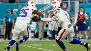 Tyrod Taylor hands off to LeSean McCoy (25) of the Buffalo Bills against the Miami Dolphins