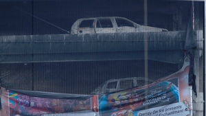 The charred vehicles remain at the multi-storey car park