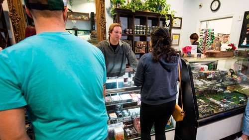 Customers at the Higher Path marijuana dispensary in the San Fernando valley area of LA