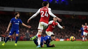 Eden Hazard goes down under a challenge from Hector Bellerin