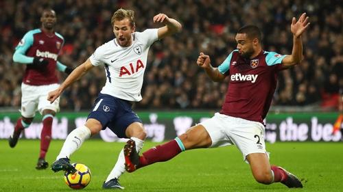 Harry Kane is challenged by West Ham's Winston Reid