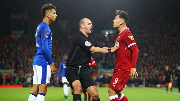 Mason Holgate and Roberto Firmino clash in the FA Cup third round tie at Anfield