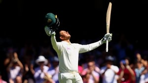Usman Khawaja celebrates after reaching his century during day three of the Fifth Test