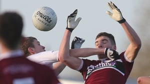 St Mary's Jarlath Og Burns and Ben McDonnell of Tyrone compete in the air