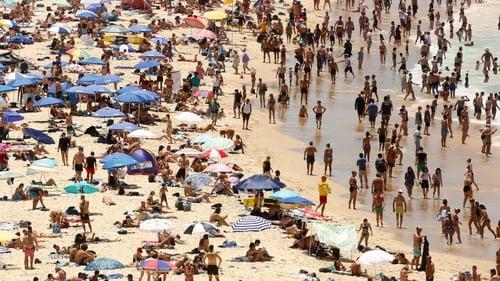 Sun-seekers descend on Bondi beach in Sydney, Australia
