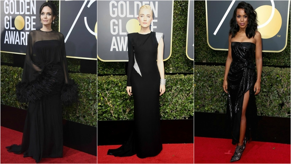 Hollywood paints the red carpet black at Golden Globes