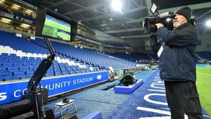 A cameraman films the the Video Assistant Referee system at Brighton's stadium