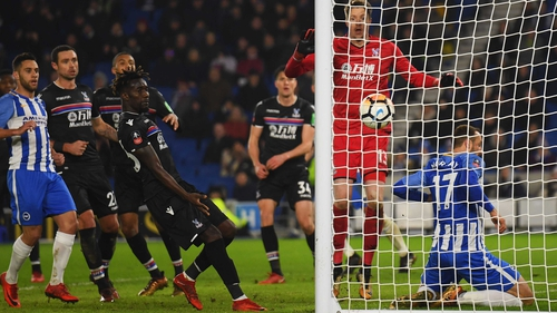 Glenn Murray slides into the net as he scores the winner