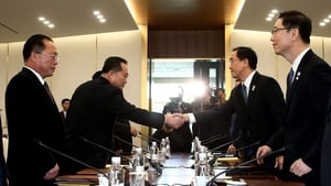 South Korea Unification Minister Cho Myung-Gyun (2nd R) shakes hands with North Korean chief delegate Ri Son-Gwon (2nd L)