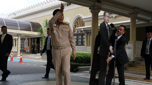 Prayuth Chan-ocha exits the stage, leaving the cut-out to 'answer questions'