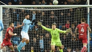 Sergio Aguero leaps to score the winner