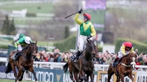 Robbie Power steered Sizing John up the Cheltenham hill to win the blue riband