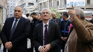 UN humanitarian chief Mark Lowcock (C) during visit to Syrian city of Homs