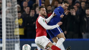 Shkodran Mustafi and Eden Hazard battle for possession
