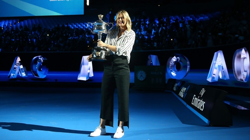 Sharapova with the Daphne Akhurst Memorial Cup at the Aussie Open draw