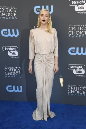 For the Critics Choice Awards the 23-year-old wore a Michael Kors dress, Giuseppe Zanotti shoes, Messika jewellery and a Jimmy Choo clutch.