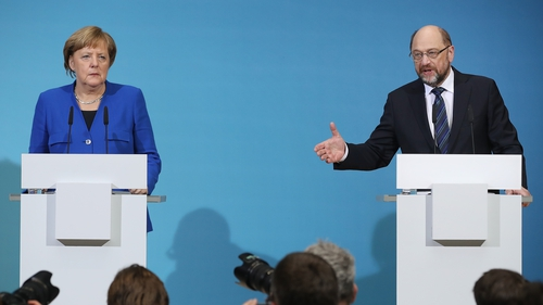 SPD leader Martin Schulz (R)  with Chancellor Angela Merkel (L)