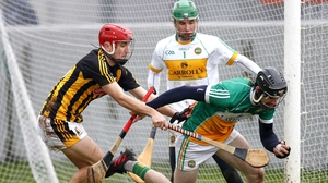 Offaly's Ben Conneely and Bill Sheehan of Kilkenny tussle for possession