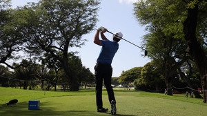 Charles Howell III plays his shot from the eighth tee at Waialae Country Club