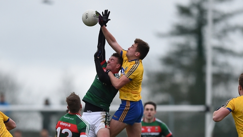 Enda Smith and Danny Kirby tussle in Roscommon's clash with Mayo in the FBD League