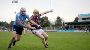 Dublin's Alan Moore (L) battles with Simon Donohoe at Parnell Park