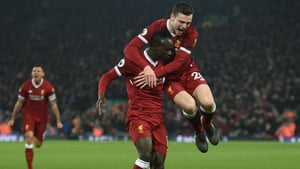 Sadio Mane is mobbed by Andy Robertson after his goal