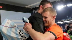 Friends Donnacha Ryan and Keith Earls embrace after the game