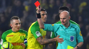 Nantes' Brazilian defender Diego Carlos (C) receives a red card, much to his dismay