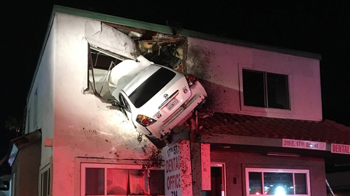 Auto flies into the second floor of California office building