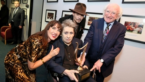 Shane MacGowan is presented with his NCH Lifetime Achievement Award by President Michael D. Higgins, in the company of his partner Victoria Mary Clarke and Johnny Depp.