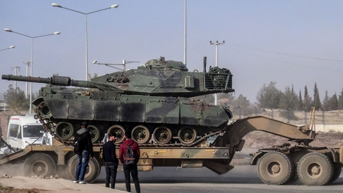 The military build-up on Turkey's southern border includes tanks, special forces, army units and Turkish-backed Syrian rebels