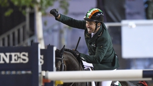 Cian O'Connor celebrates after riding his horse Good Luck to a clear round, sealing victory for the Irish team in Gothenburg
