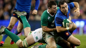 Morgan Parra is tackled by Robbie Henshaw during the 2015 Six Nations