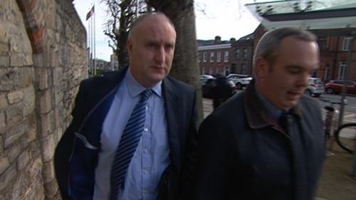 Garda Fergal O'Flaherty (left) said he recognised one of the people in the photograph as Patrick Hutch