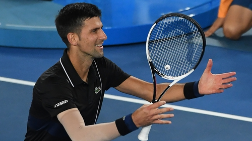 Djokovic outlasts Monfils in Melbourne heat