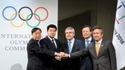 IOC President Thomas Bach alongside representatives from North Korea and South Korea at today's talks in Switzerland