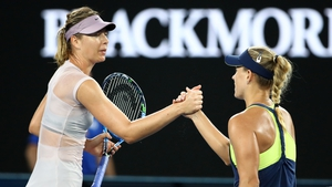 Angelique Kerber of Germany is congratulated by Maria Sharapova