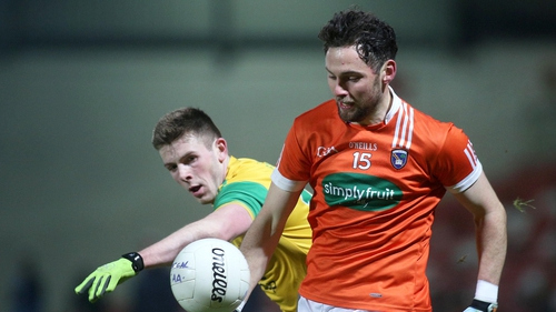 Armagh's Oisin MacIomhair and Eoghan Ban Gallagher of Donegal