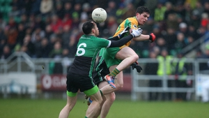 Fulham's Hurl Dockry tackles Corofin's Colin Brady