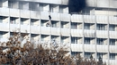 People use sheets to climb down floors at the Intercontinental Hotel during the attack