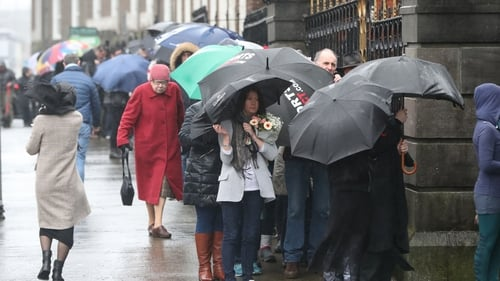 People queued outside the church to file past the open coffin and pay their respects