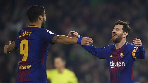 Lionel Messi and Luis Suarez celebrate
